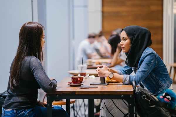 people sitting beside tables indoors